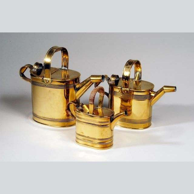 Three Matched Graduated Oval Brass Watering Cans